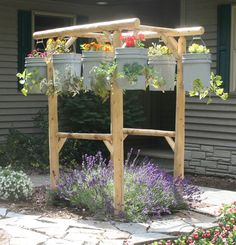 This is so cool.  Wonder if I could get my hubby to build me one?  :)  Container garden in the air.
