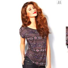 Cute Aztec Shirt:) i love her hair and makeup