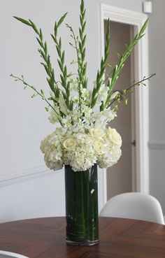 Table Centrepiece - Hydrangea, Orchids, Gladioli, Roses withouth the roses. Love this arrangement Gladiolus Arrangements, Funeral Floral Arrangements, Church Flower Arrangements, Vase Arrangements, Gladiolus Centerpiece, Centerpieces, Gladiolus Wedding Bouquet, Gladiolus Flower, Wedding Flowers