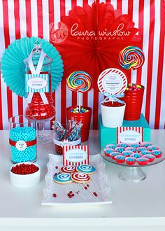 LOVE the glass jars with red & aqua candies. This would be cute for a dr. seuss or carnvial themed birthday.