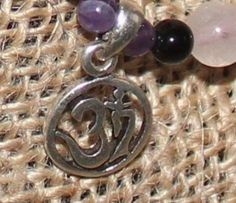 "Lovely 925 sterling silver ""Om"" symbol on adjustable bracelet of black Onyx, Amethyst and Rose Quartz"