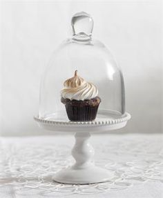 Small White Porcelain Cupcake Stand with Glass Dome. $29.9 add some color by combining the pink, blue and white porcelain cupcake pedestals.