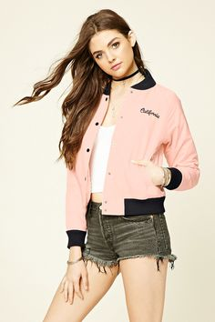 """A lightweight woven baseball jacket with contrast ribbed trim, an embroidered """"California"""" graphic on the front, a buttoned front, long sleeves, slanted front pockets, quilted lining, and a """"Support Your Local Girl Club"""" graphic embroidered on the back."""