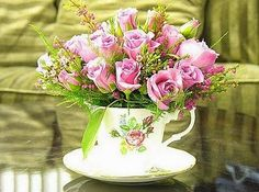 Beautiful arrangement of pink roses in a tea cup....