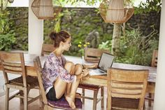 Young woman at home with laptop
