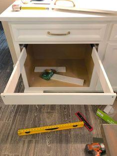 DIY Hanging File Drawer in Kitchen Cabinet - Frills and Drills Diy Laundry, Drawers, Diy Hanging, Diy File Cabinet, Hanging Files, Basket Drawers, Diy Laundry Basket, Diy Drawers, Framed Kitchen Cabinets