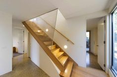 Modern Futuristic House Inspiration for Your House: Wooden Staircase In Fantastic Futuristic House Design With Wall Lighting Under Wooden Hand Railing Stair And Wooden Floor Also Granite Floor With White Ceiling And White Door Plus Glass Wall ~ jangrue.co