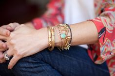 "Maya's arm party consists of her own delicate designs with black diamonds, a gold ""M"" and Chrysophase stone.  She layers these with her Stella & Dot Serpent bangle and Renegade Cluster bracelet."