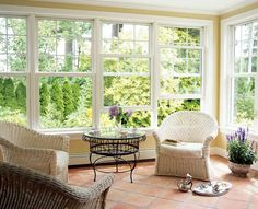 Simple sun room addition with windows like this and light slate or natural stone of some kind (brick shaped in herringbone pattern)