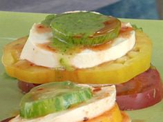 Get Fresh Mozzarella and Stacked Heirloom Tomato Salad with Green Chile-Cilantro Oil and Chipotle Vinegar Recipe from Cooking Channel