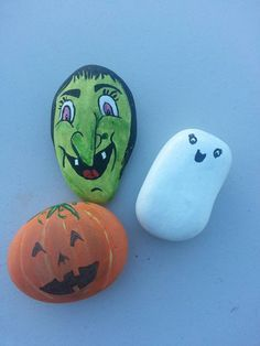 Three rocks a witch, jack olantern and ghost. Acrylic painted rocks.