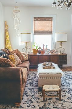 Tribal patterns + earthy tones pair perfectly with a leather sofa and wooden furniture.