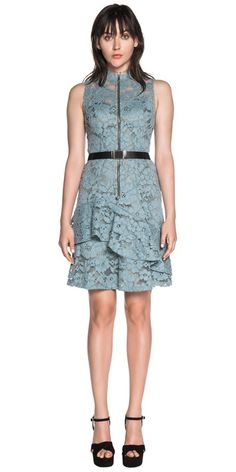 Made from a corded lace this sleeveless dress features a high neckline and fitted bodice with an asymmetric ruffle on the skirt. Fully lined. Fastened with a metal zip at the centre back. Made in Australia.