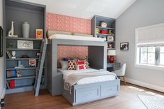 The upper bunk is known as the Loft Lounge and is for reading only, not sleeping, due to the lack of railings. Built-in shelves provide plenty of room for the son's growing book collection and other favorite things. It also incorporates a desk for homework.