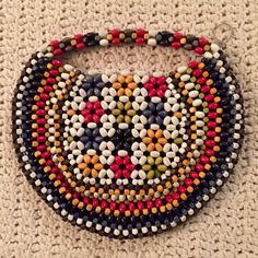 """Vintage 1940s Wood Bead Hand Clutch Colorful wood bead clutch from the 1940s.  Made in Czechoslovakia.  In excellent vintage condition with all beads in tact.  Approx. 8"""" x 10"""". Bags Clutches & Wristlets"""