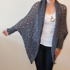 This lacy, over-sized cardigan features bat-wing sleeves, ribbed cuffs and a generous, lacy, shawl collar. This is a versatile pattern: try it in cotton for a light sundress cover-up, or use a lofty acrylic and pair it with skinny jeans for fall.