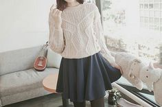 Winter outfit. White sweater, black circle skirt, black tights