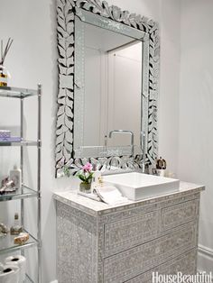 The clean lines elegantly break up the medley of shapes and textures. See more of Rebecca Minkoff's stylish bathroom »