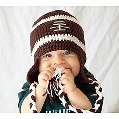 @Overstock - Score a touchdown this perfect gift for your little sports fan. This football design cap is crafted with deep brown 'pigskin' and white stitches, accented with two dual colored tassels. Perfect for a chilly day at the game or a wintry tailgate party.http://www.overstock.com/Main-Street-Revolution/Knitnut-by-JL-Childs-Cotton-Crocheted-Football-Hat/6466712/product.html?CID=214117 $17.99