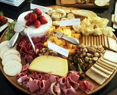 Cheese Platter - some ideas: crackers (Wheat Thins, Triscuits, Melba toast, Ritz), grapes and other fruit, salami, nuts, cheese (cheddar, Swiss, Colby, provolone, etc.)