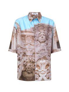 Camisa estampada con corchetes de metal y nacar. Manga corta