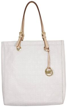 This Michael Kors Jet Set North South Tote is a gorgeous and versatile bag.  In creamy Vanilla Michael Kors MK embossed leather, the North South shape is easy to carry; large enough to fit all you need but slim and not bulky on your shoulder.    Ideal for everyday or any season.  Inside is deep and roomy and offers a hanging side zip compartment and a side slip pocket.  Vachetta leather handles with an 8 inch drop.  Gold tone hardware including M...