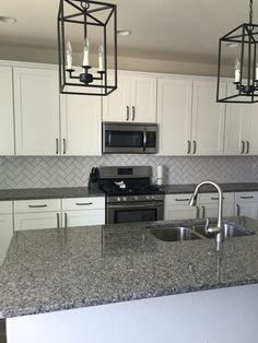 white kitchen cabinets with calodonia granite countertops and white tile backsplash - Google Search