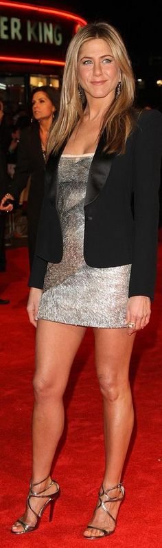 Who made Jennifer Aniston's silver sandals, black jacket, silver dress, jewelry and clutch that she wore to the UK film premiere of The Bounty Hunter at London's Vue West End?