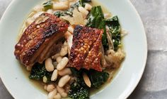 Get cracking: pork belly with cannellini beans and cavolo nero. Also recipe for rhubarb sponge- English style, all by Nigel Slater