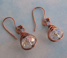 Clear Crystal Earrings with Antique Copper item ECEAE. $24.00, via Etsy.