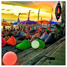 Seminyak beach bar is the best place to relax in big colorfull beanbags and watch the beautiful sunset in Bali. Places Around The World, Oh The Places You'll Go, Places To Travel, Places To Visit, Bali Lombok, Bali Baby, Bali Holidays, Best Rooftop Bars, Parasols