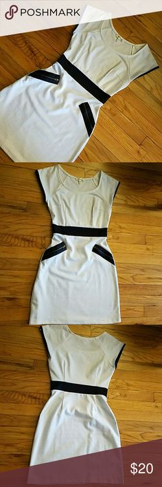"""*WEEKEND SALE* White dress with black details Comfortable white dress with black waist band and black """"pockets"""" with zipper detailing. Very flattering and only worn once! Monteau Dresses Mini"""