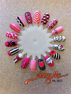 nancymcnails:  PINK!  Ladies and gentlemen, this is one of the most exciting sample wheels Ive ever seen. So many options, so many new styles I havent seen before! I love the eyes, and the pink squiggle next to them intestines? icing? Whichever, very cool.