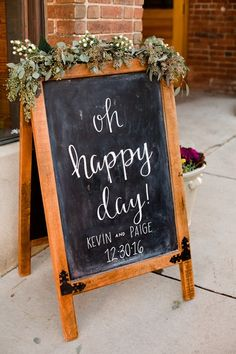 """Elegant wedding sign idea - chalkboard sign with greenery + """"oh happy day"""" in modern calligraphy {JOPHOTO}"""