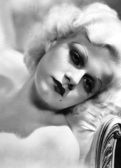 Harlow....thin penciled eyebrows, bow mouth and oh THAT BEAUTY MARK....chic beauty...& vulnerability...in the 30's