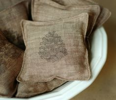 DIY: sew cloth scraps to make sachets for pine needles or dried lavender. Use a stamp with cloth paint to mark what's inside.