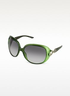 4600e4c3f5 With a pop of color and flirty charm Christian Dior s oversized rounded  sunglasses showcase a high gloss finish and cut-out circlular temple detail  with ...