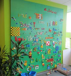 Lego Wall: I would do this on a smaller scale, but I love the idea of using the big Lego Plates as a canvas.