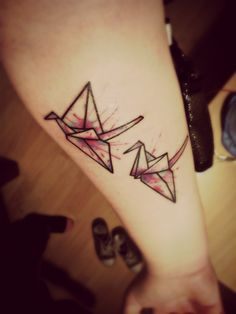 Origami crane tattoo with splattered colour effect