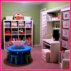 Perfectly organized playroom.  Loving the labeled toy bins and baskets with pictures.