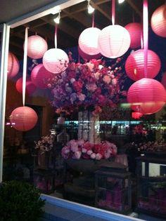 Pink lanterns and floral arrangements