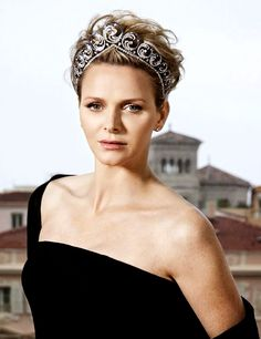 Princess Charlene of Monaco wearing Ocean Tiara during a photo sessions for Hola magazine. There are over 1200 stones in it, both diamonds and sapphires. It can be worn as both a tiara and a necklace, and there is also a pair of matching earrings. Charlene hasn't worn the piece very often, though it has been on display at the Oceanographic Museum in Monaco