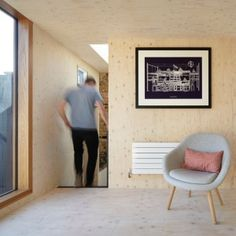 Studio+Octopi+adds+plywood-lined+loft+extension+to+RCA+professor's+house