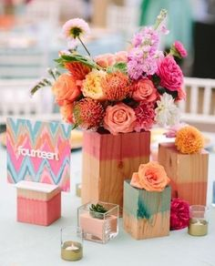 Modern wedding centerpiece idea - wooden vessels dyed with bright colors + bright flowers {Joielala Photo}
