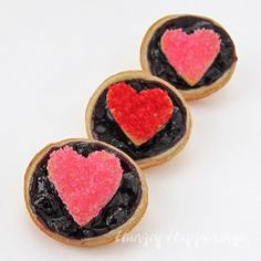 mini blueberry tarts with heart-shaped sugar-coated pie crusts on top