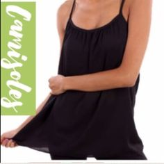 RACERBACK CAMIS IN BLACK! These are so cute and look great with or without a jacket. Dress them up or wear to the gym! Semi sheer, 100% polyester. NWOT. Made in USAPLEASE DO NOT BUY THIS LISTING! I will personalize one for you. tla2 Tops