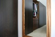 Fumed oak wardrobes with walnut drawers