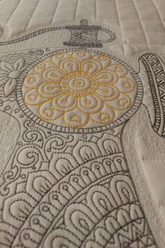 Now adding embroidery to our quilting for you!