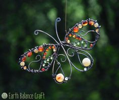 Peacock Butterfly Suncatcher - A decorative copper wirework butterfly with carnelian, agate, aventurine and peridot gem stone beads.