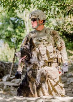 U.S. Army Spc. Casey Bates, of Yakima, Wash., a dog handler with Route Clearance Patrol-29, Alpha Company, 4th Brigade Special Troops Battalion, 4th Infantry Brigade Combat Team, 1st Infantry Division, and his tactical explosives detection dog, Argo, secure an area in the mountains of Paktika province, Oct. 9, 2012. RCP-29 spent three days and three nights working nonstop to clear the route of improvised explosive devices for a U.S. Army convoy.